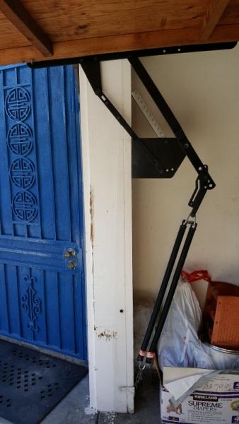 Left Side Repaired Garage Door Hinge and Spring