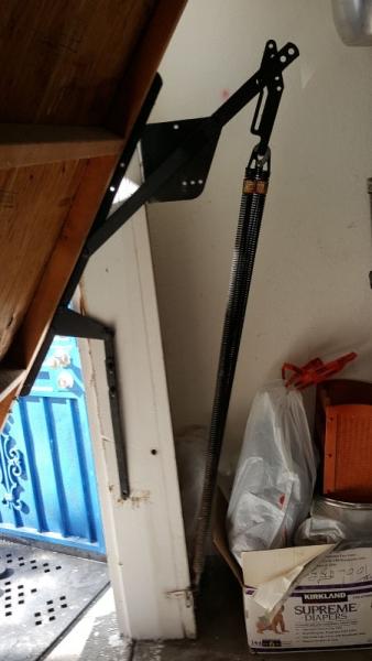 Left Side Broken Garage Door Hinge and Spring