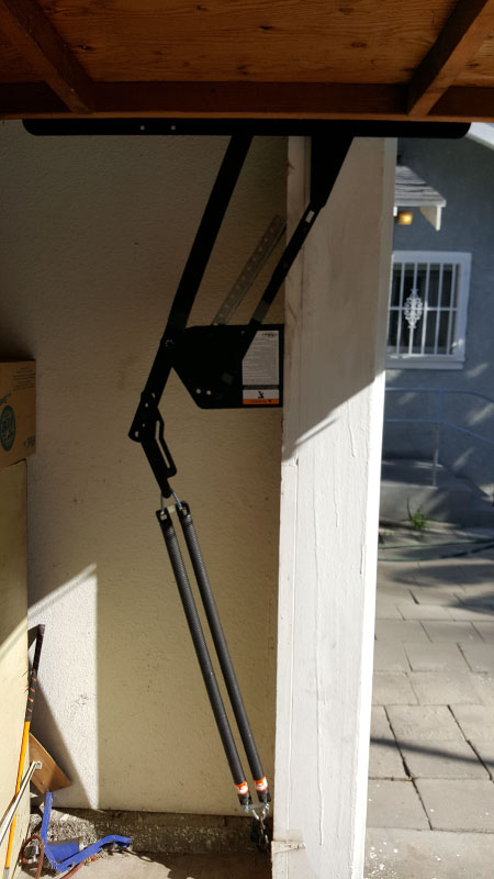 Right Side Repaired Hinge and Cable Mechanism on Garage Door